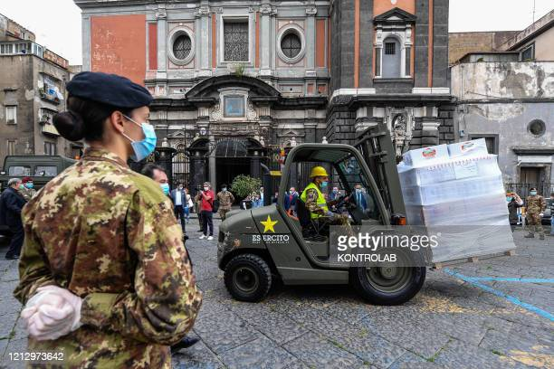 CHURCH NAPLES CAMPANIA ITALY Sodiers of Italian Army wearing face masks use a forklift to supply food to the assistance center for the poor in the...
