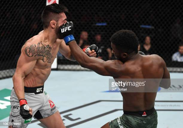 Sodiq Yusuff punches Suman Mokhtarian of Australia in their featherweight bout during the UFC Fight Night event inside Adelaide Entertainment Centre...