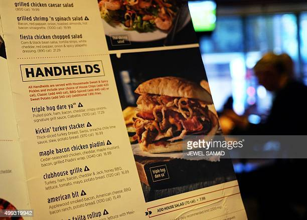 Sodium warning signs are seen next to a dish on the menu at an Applebee's in New York on November 30 2015 The New York City Health Departments sodium...