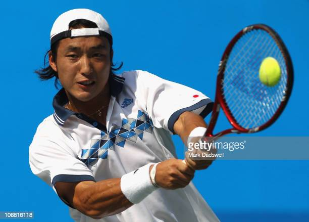 Soeda Go of Japan hits a backhand return in the Men's Team Tennis Quarterfinal match against Zhang Ze of China at the Aoti Tennis Centre during day...