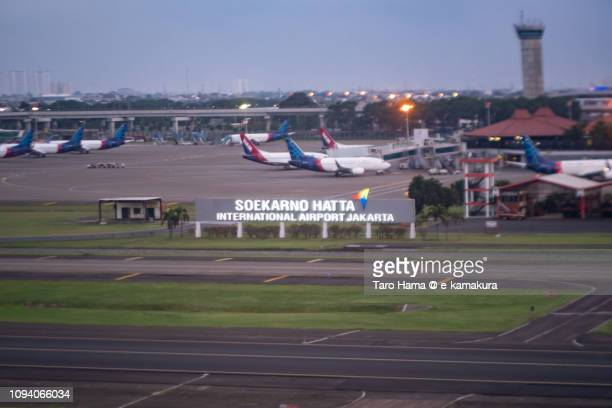 Soekarno–Hatta International Airport (CGK) in Indonesia sunset time aerial view from airplane