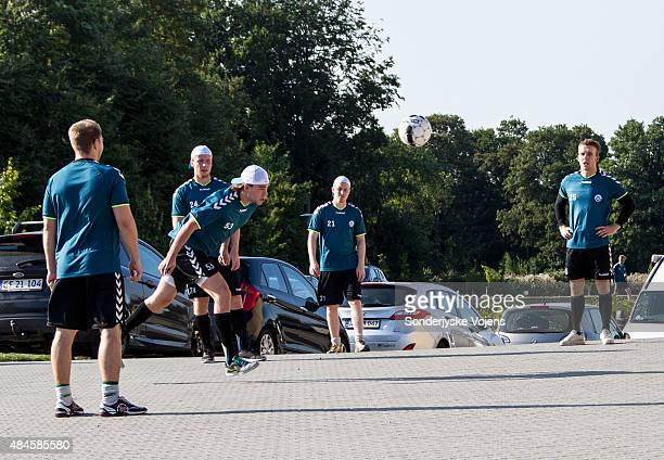 Soenderjyske players relax with a game of football in the carpark before warm up during the Champions Hockey League group stage game between...