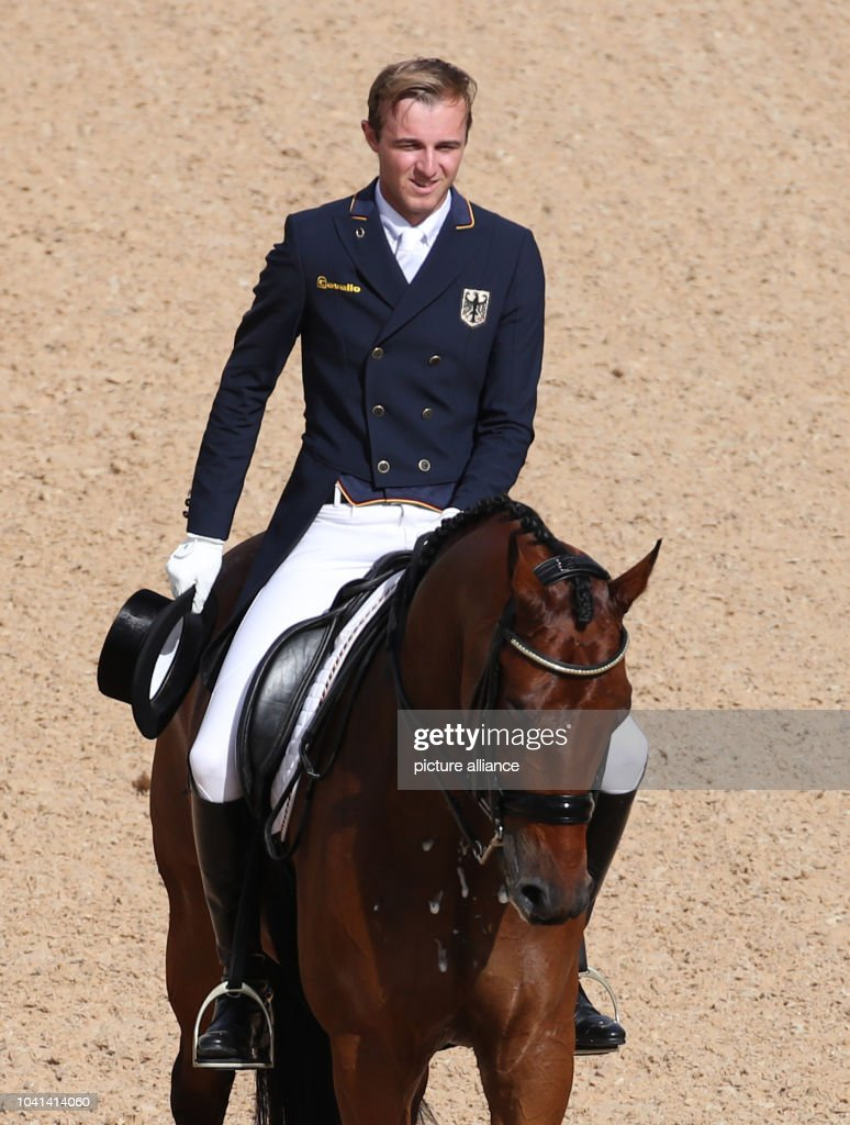 Soenke Rothenberger of Germany on horse Cosmo in action during the ...