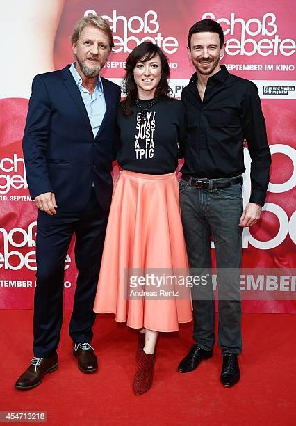 Soenke Wortmann Charlotte Roche and Oliver Berben attend the premiere of the film 'Schossgebete' at Residenz Astor Film Lounge on September 5 2014 in...