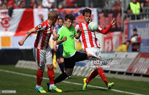 Soeren Bertram and Jonas Acquistapace of Halle challenges Tom Baumgart of Chemnitz during the Third League match between Hallescher FC and Chemnitzer...