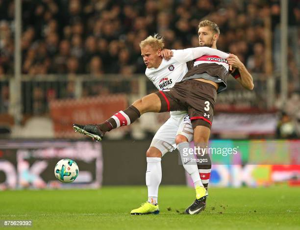 Soeren Bertram of Aue and Lasse Sobiech of Pauli battle for the ball during the Second Bundesliga match between FC St Pauli and FC Erzgebirge Aue at...