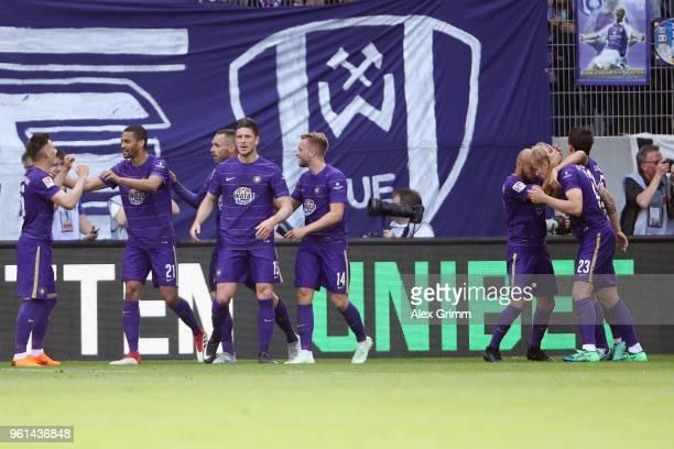 Soeren Bertram of Aue celebrates his team's first goal with team mates during the 2 Bundesliga Playoff Leg 2 match between Erzgebirge Aue and...