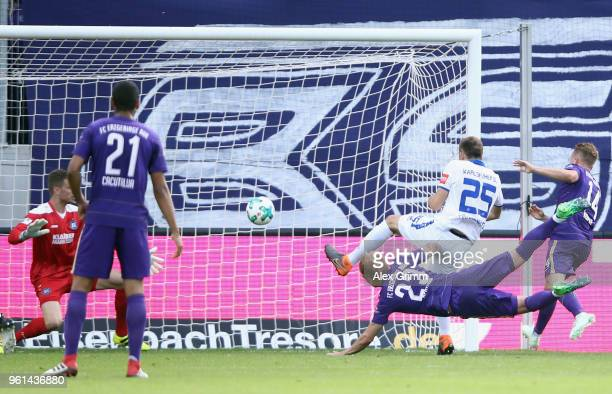Soeren Bertram of Aue scores his team's first goal during the 2 Bundesliga Playoff Leg 2 match between Erzgebirge Aue and Karlsruher SC at...