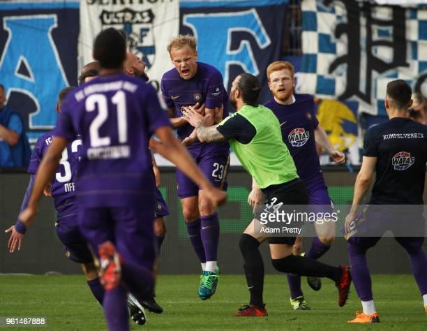 Soeren Bertram of FC Erzgebirge Aue celebrates after scoring his third goal in the relegation 2018 2 Bundesliga Playoff Leg 2 match between...