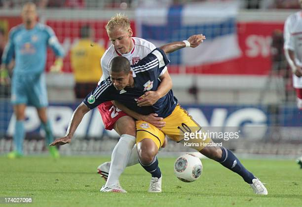 Soeren Bertram of Halle and Thiago Rockenbach Da Silva of Leipzig compete for the ball during the 3rd Liga match between Hallescher FC and RB Leipzig...