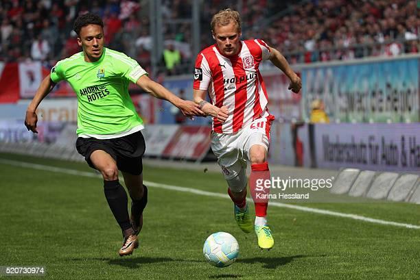 Soeren Bertram of Halle challenges Jamil Raphael Dem of Chemnitz during the Third League match between Hallescher FC and Chemnitzer FC at Erdgas...