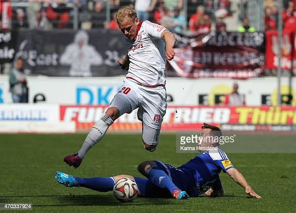 Soeren Bertram of Halle challenges Maik Kegel of Kiel during the Third League match between Hallescher FC and Kieler SV Holstein at Erdgas Sportpark...