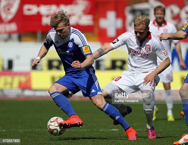 Soeren Bertram of Halle challenges Patrick Breitkreuz of Kiel during the Third League match between Hallescher FC and Kieler SV Holstein at Erdgas...