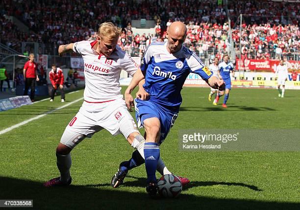 Soeren Bertram of Halle challenges Patrick Herrmann of Kiel during the Third League match between Hallescher FC and Kieler SV Holstein at Erdgas...