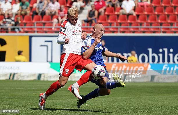 Soeren Bertram of Halle challenges Patrick Herrmann of Kiel during the Third League match between Hallescher FC and Holstein Kiel at Erdgas Sportpark...