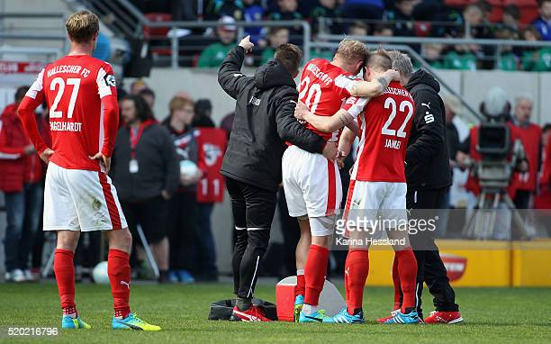 Soeren Bertram of Halle is brought from the pitch after an injury during the Third League match between Hallescher FC and Chemnitzer FC at Erdgas...