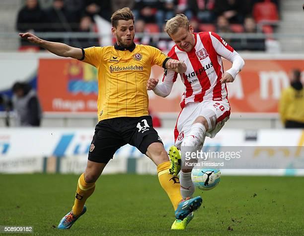 Soeren Bertram of Halle is challenged by Justin Eilers of Dresden during the Third League match between Hallescher FC and SG Dynamo Dresden at erdgas...