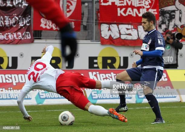 Soeren Bertram of Halle is challenged by Luka Marino Odak of Erfurt during the 3rd Liga match between Halle and Erfurt at ErdgasSportpark on October...