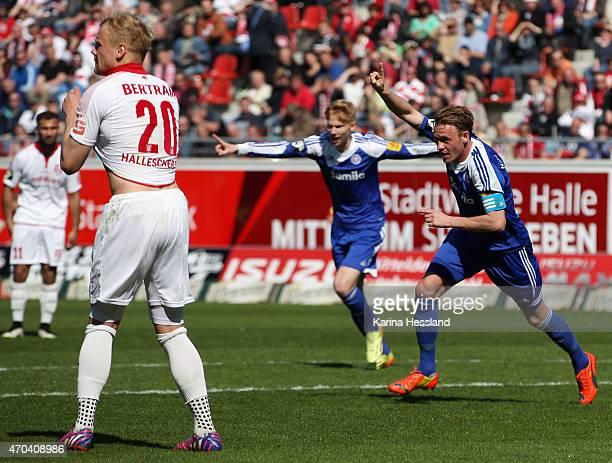 Soeren Bertram of Halle looks dejected Rafael Kazior of Kiel celebrates the fourth goal during the Third League match between Hallescher FC and...