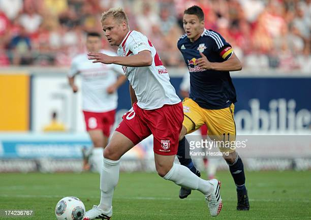 Soeren Bertram of Halle on the ball behind him Daniel Frahn of Leipzig during the 3rd Liga match between Hallescher FC and RB Leipzig at Erdgas...