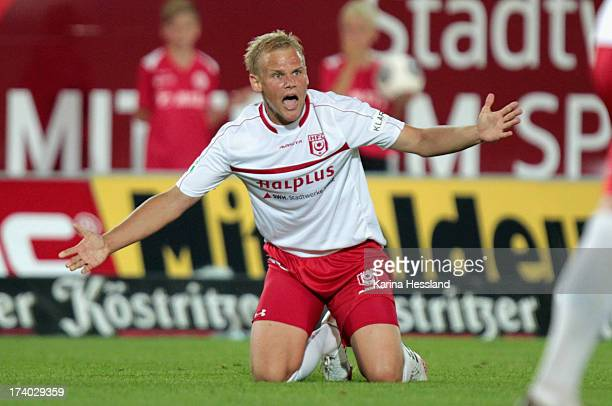 Soeren Bertram of Halle reacts during the 3rd Liga match between Hallescher FC and RB Leipzig at Erdgas Sportpark on July 19 2013 in Halle/Germany