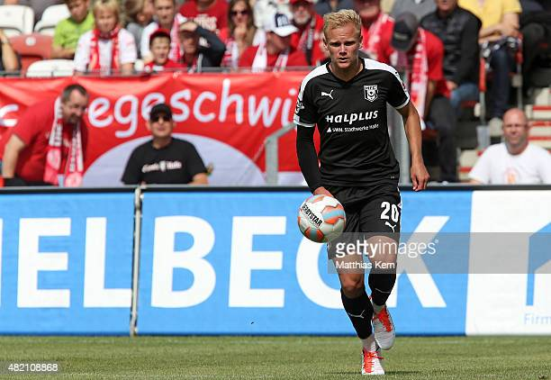 Soeren Bertram of Halle runs with the ball during the third league match between FC Energie Cottbus and Hallescher FC at Stadion der Freundschaft on...