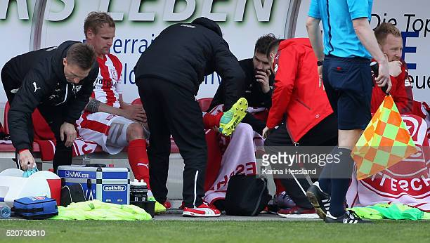 Soeren Bertram of Halle with injury on the bench during the Third League match between Hallescher FC and Chemnitzer FC at Erdgas Sportpark on April...
