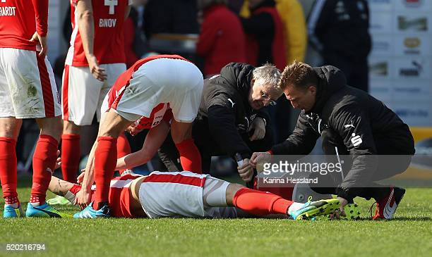 Soeren Bertram of Halle with injury on the ground during the Third League match between Hallescher FC and Chemnitzer FC at Erdgas Sportpark on April...