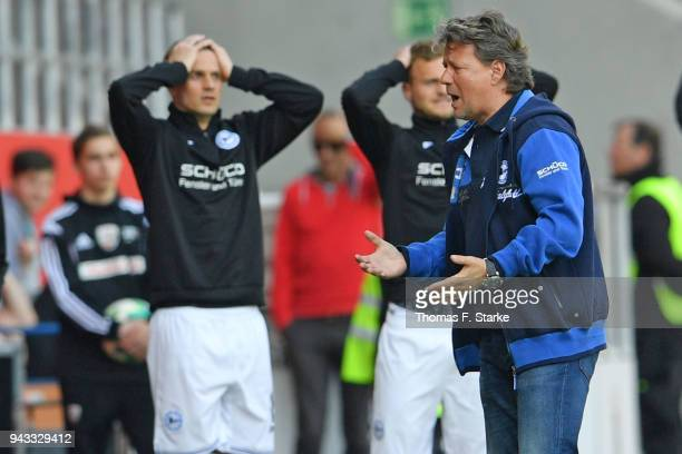 Soeren Brandy Christoph Hemlein and head coach Jeff Saibene react during the Second Bundesliga match between FC Ingolstadt 04 and DSC Arminia...