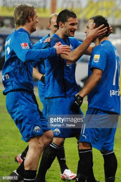 Soeren Brandy Enis Alushi and Mahir Saglik of Paderborn celebrate their first goal during the Second Bundesliga match between SC Paderborn and 1860...