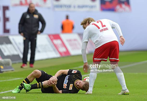 Soeren Brandy of 1FC Union Berlin is verletzt during the game between RB Leipzig and 1 FC Union Berlin on March 1 2015 in Leipzig Germany