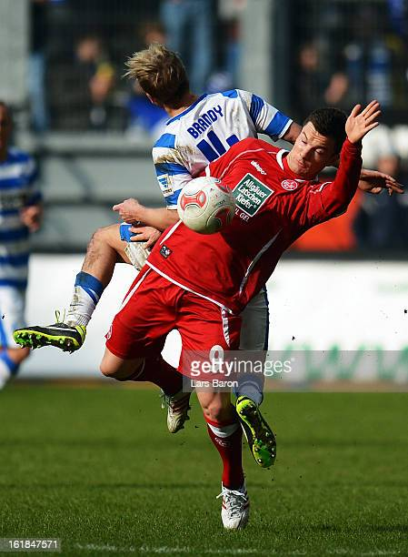 Soeren Brandy of Duisburg challenges Alexander Baumjohann of Kaiserslautern during the Second Bundesliga match between MSV Duisburg and 1 FC...