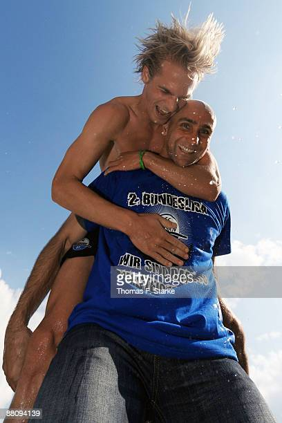 Soeren Brandy of Paderborn celebrates the ascension to the Second Bundesliga with his head coach Andre Schubert after winning the Second Bundesliga...
