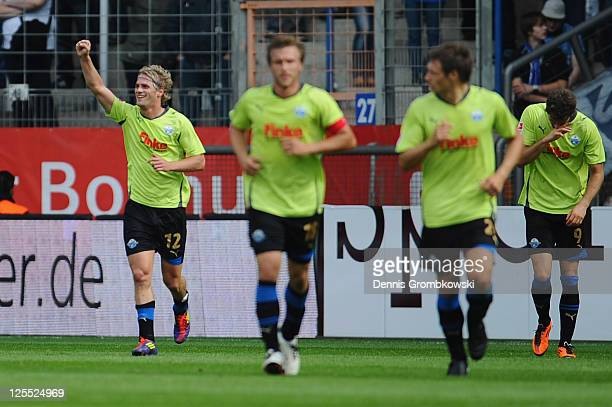 Soeren Brandy of Paderborn celebrates with team mates after scoring his team's opening goal during the Second Bundesliga match between VfL Bochum and...