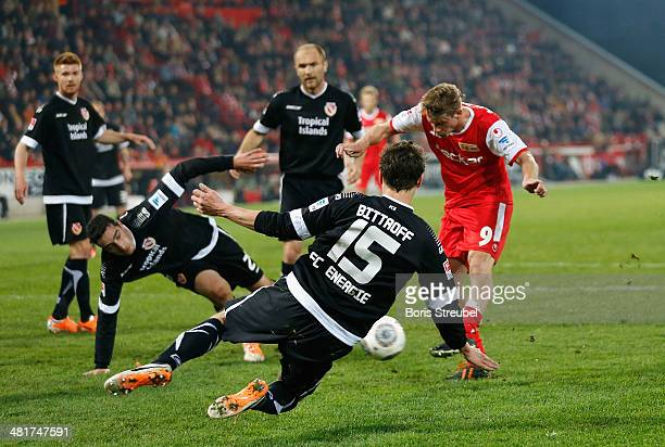 Soeren Brandy of Union Berlin scores his team's first goal during the Second Bundesliga match between 1.FC Union Berlin and Energie Cottbus at...