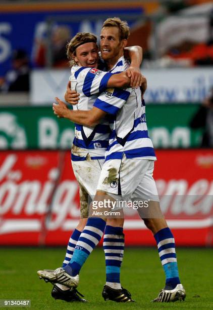 Soeren Larsen of Duisburg celebrates his team's third goal with team mate Adam Bodzek during the Second Bundesliga match between MSV Duisburg and 1FC...