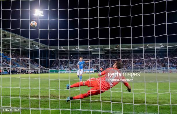 Soeren Reddemann of Chemnitz misses to score his team's last penalty in the shoot-out after extra time past goalkeeper Daniel Heuer Fernandes of...