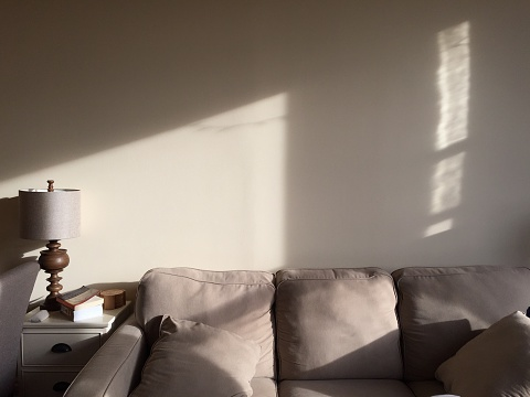 Sofa Against Wall With Sunlight At Home - gettyimageskorea