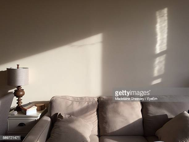 Sofa Against Wall With Sunlight At Home
