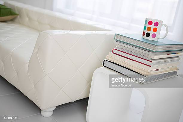 Sofa and a stack of books