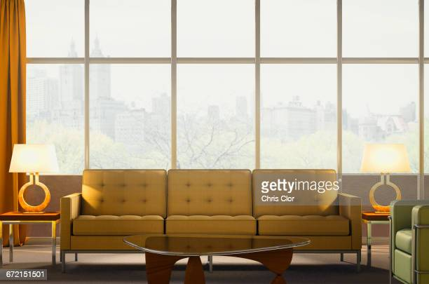 sofa and armchair in modern penthouse apartment - penthouse_apartment stock pictures, royalty-free photos & images