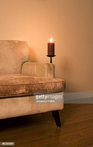 sofa and candle - jessamyn harris stock pictures, royalty-free photos & images