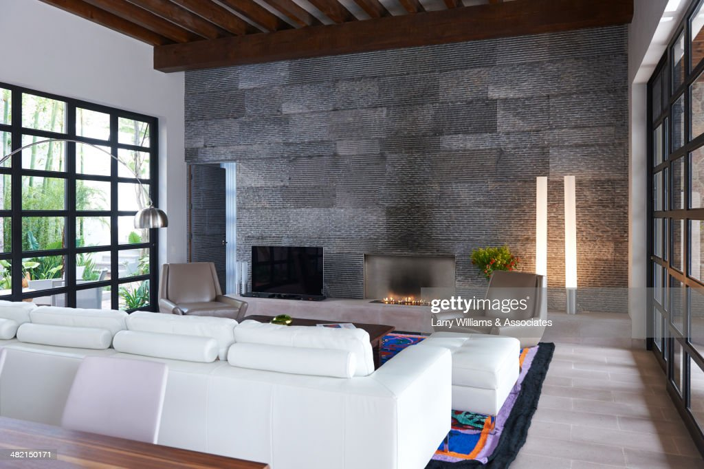 Sofa And Stone Wall In Modern Living Room : Stock Photo