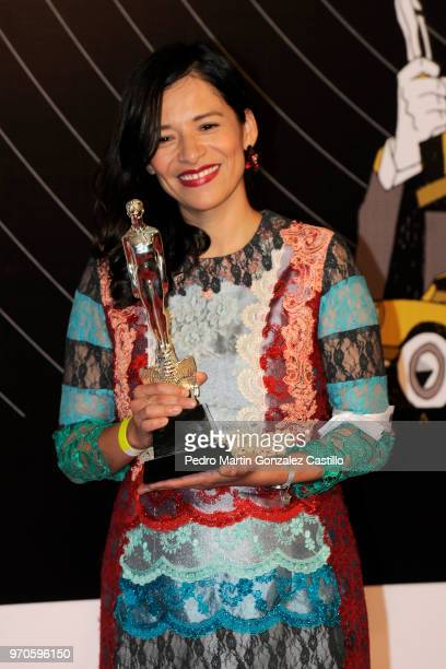 Sofía Carrillo poses with the Ariel Award for Best Animated Short Film for 'Cerulia' during 60th Ariel Awards at Palacio de Bellas Artes on June 5...