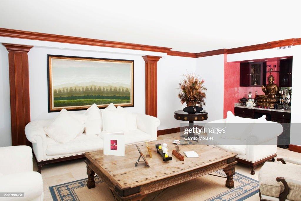 Sofa, coffee table and wall art in living room : Foto stock