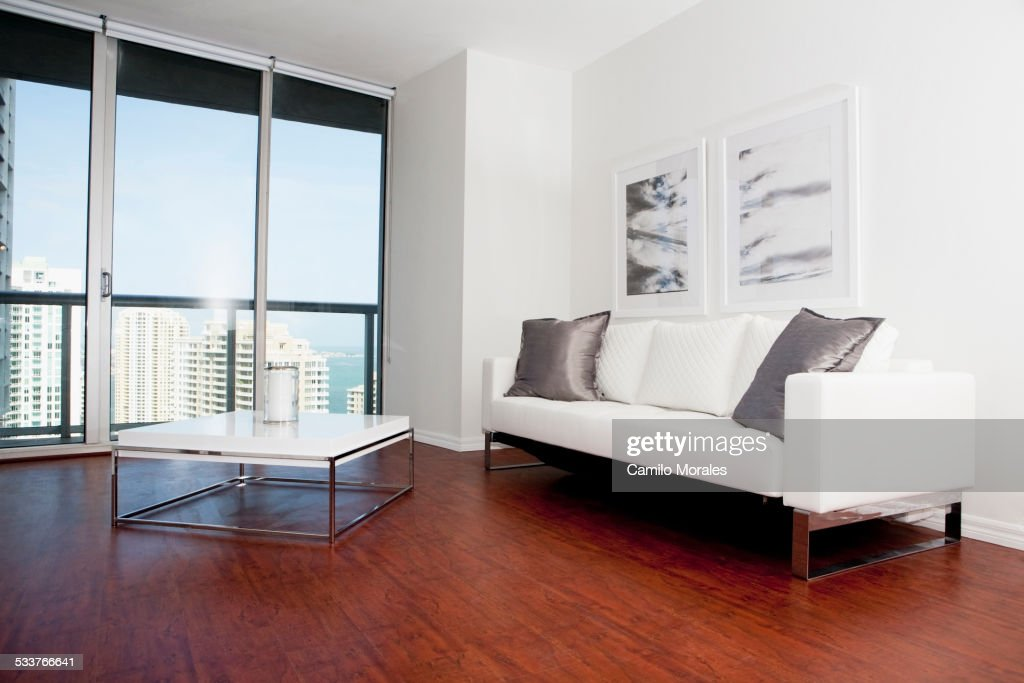 Sofa, coffee table and windows in modern living room : Foto stock