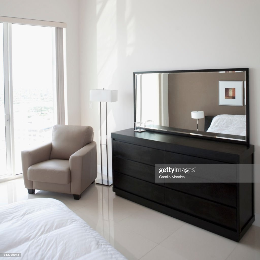 Sofa, dresser and mirror in modern apartment : Foto stock