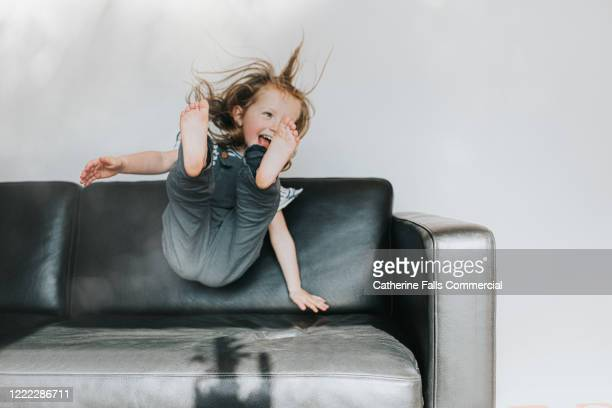 sofa flop - happiness stock pictures, royalty-free photos & images