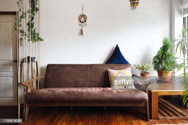 sofa in a modern nature themed living room - sofa stock pictures, royalty-free photos & images