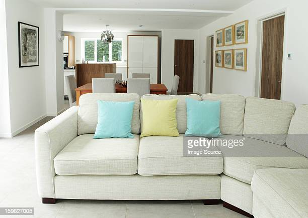 sofa in living area - cushion stock pictures, royalty-free photos & images